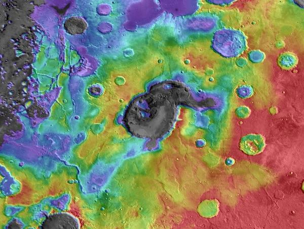 This image shows digital elevation data overlaid on daytime thermal infrared images of Eden Patera, a depression on Mars now thought to be the remnant of an ancient supervolcano. Red colors are relatively high and purple-gray colors are low.