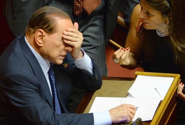 Former Prime Minister Silvio Berlusconi attends the Italian Senate vote Wednesday. He had prompted Parliament's confidence vote on Italy's government by ordering five ministers in his party to resign from the Cabinet.