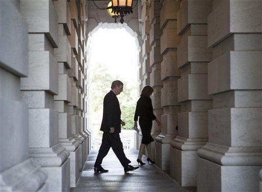 Senate Minority Leader Mitch McConnell (R-Ky.) departs the Capitol en route to the White House to meet with President Obama and other congressional leaders.