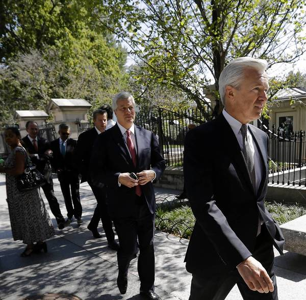 Wells Fargo Chief Executive John Stumpf, right, followed by JPMorgan Chief Executive Jamie Dimon, walks outside the White House after financial industry leaders met with President Obama to discuss the debt ceiling.