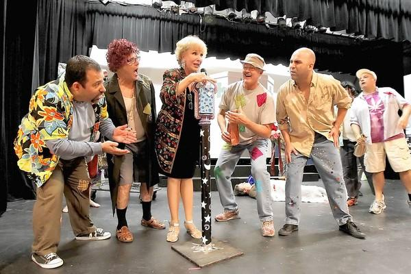 Cast members surround Pat Kollenda during rehearsals for the 2012 Lagunatics show. This year's show has been postponed due to mold found at the Forum Theater.