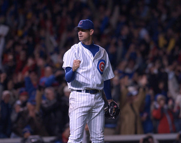 Cubs pitcher Mark Prior celebrates his complete-game victory in the playoffs over Atlanta in 2003.