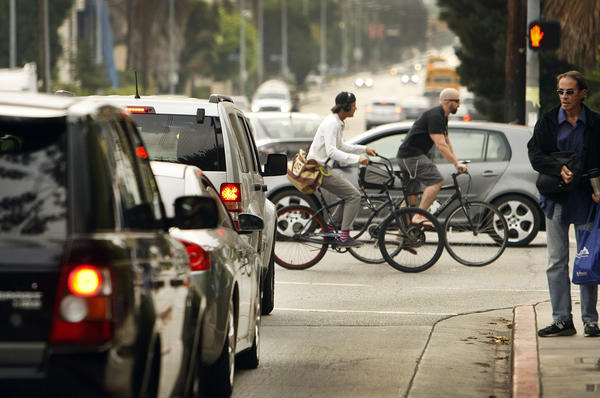 """Pedestrians and cyclists are counted crossing Bundy Drive at Idaho Avenue in West Los Angeles on September 10, 2013 for the """"2013 L.A. Bikes and Ped Count,'' a count of bicyclists and pedestrians organized every two years by the Los Angeles County Bicycle Coalition and L.A. Walks. (Los Angeles Times)"""