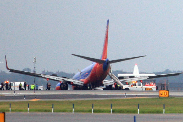 A Southwest Airlines airplane after the plane's landing gear collapsed shortly after touching down on the runway, at LaGuardia Airport in Queens.