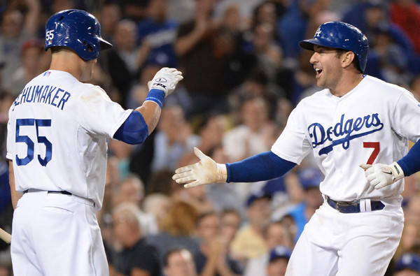 Veteran utility players Nick Punto (7) and Skip Schumaker -- celebrating a home run by Punto in a victory over the New York Mets -- bring the Dodgers much-needed postseason experience.