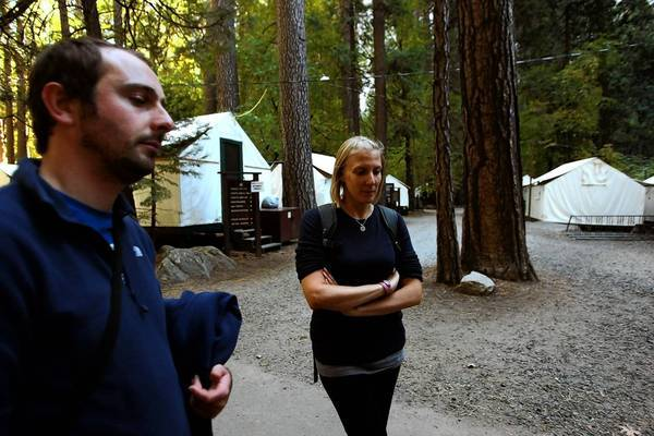 "Campground and hotel reservations inside Yosemite National Park were no longer being honored Wednesday because of the federal government shutdown; visitors were issued refunds and were told that they could no longer enter the park. ""This was supposed to be the highlight of our trip,"" said Gemma Edwards, 35, right, standing next to her boyfriend, Stuart Ackroyd, 33, in Yosemite's Curry Village. The pair were visiting from Guildford, England."