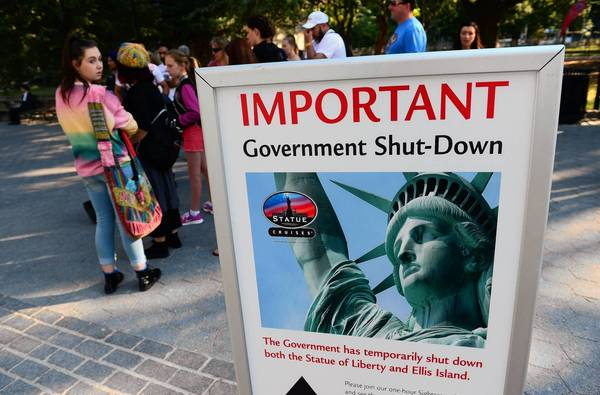 A sign announces Tuesday that the Statue of Liberty in New York City is closed because of the U.S. government shutdown. Federal institutions and national parks were closed and thousands of employees furloughed after Congress was unable to agree on a federal budget.