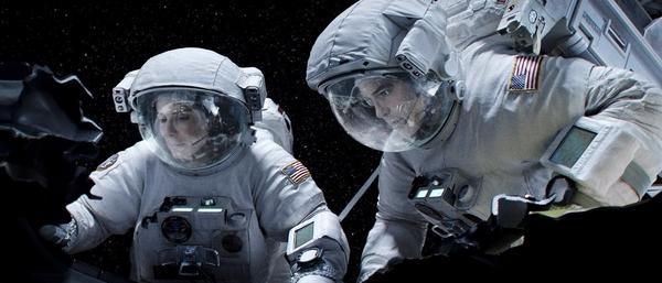 "Sandra Bullock and George Clooney star in ""Gravity."""