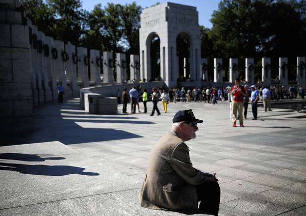 World War II and Korean War veteran Pete Bolinger, of St. Louis County, Mo., visits the World War II Memorial on Wednesday in Washington. Members of Congress came to the memorial Wednesday to make sure veterans groups would be admitted after barricades stood in veterans' way Tuesday.