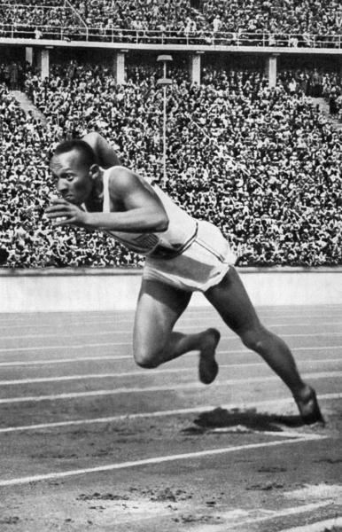 "(FILES) -- A file picture taken on August 5, 1936 shows US champion Jesse (James Cleveland) Owens powering his way at the start of the 200m event, that he won, during the Olympic Games in Berlin, where he captured 4 gold medals, 100m, 200m, 4x100m and long jump. Born on September 12, 1913, grandson of a slave and legendary athlete ""Jesse"" Owens established 6 world records in 1935. Jesse Owens retained his 100m world record for 20 years and his long jump world record for 25 years (until 1960)."