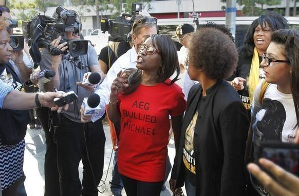 Michael Jackson fans from left, Karlene Taylor, Yvonne Francis, Latrenda White and Jamie Lee, speak out against AEG Live. A jury found Wednesday that AEG LIve was not liable in the death of the pop superstar.
