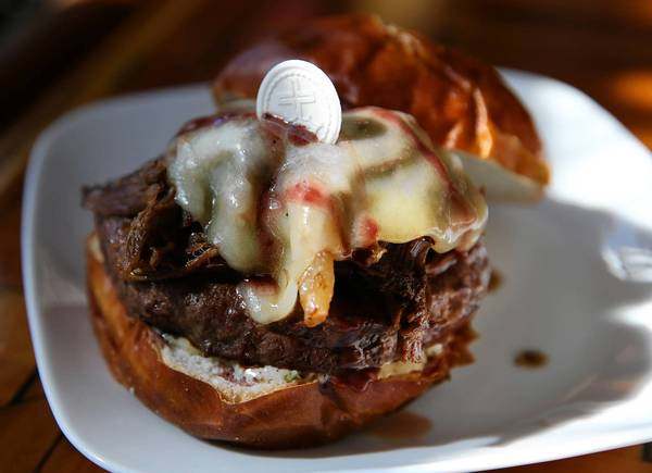 Kuma's Corner in Chicago is featuring a burger of the month called the Ghost. The 10-ounce burger is topped with a red wine reduction and an unconsecrated communion wafer. The Ghost, named after the Swedish metal band, costs $17 and comes with fries, chips or a side salad, and a portion of slowly braised goat shoulder, aged white cheddar cheese and Ghost chile aioli.