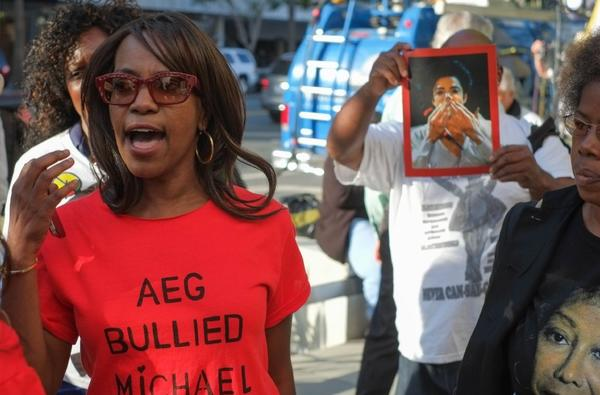 Upset supporters of the Jackson family react outside court in Los Angeles after the verdict in the AEG Live trial.