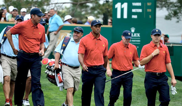 Matt Kuchar, Tiger Woods, Steve Stricker and Jordan Spieth of the U.S. Team walk off a tee box during a practice round prior to the start of The Presidents Cup at the Muirfield Village Golf Club.