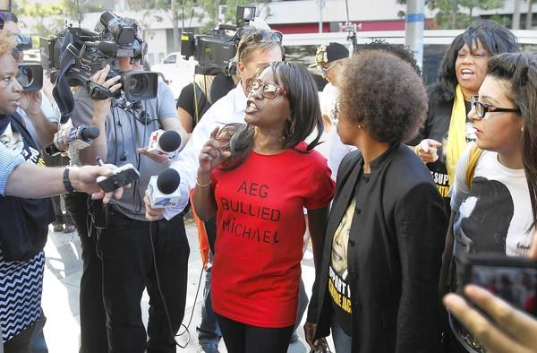 A Michael Jackson fan and her T-shirt speak out against AEG Live after the verdict.