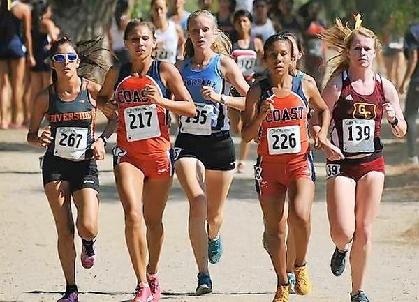 Leanne Allen (217) and Karen Silvas (226) compete for Orange Coast College at the 2013 Southern California Preview Meet.