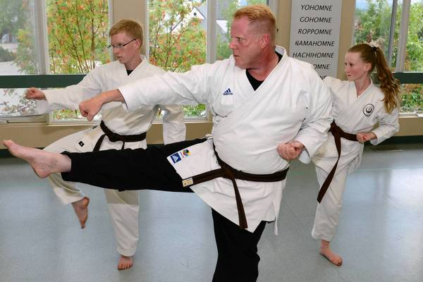 Craig Fallis with his son Bruce, 15, and daughter Susanah, 12, walk through a Karate Kata at the Sentenashi Karate School on Wednesday, Aug. 13, 2013 in Calgary, Alberta, Canada. Karate is the activity the Fallis' do together to stay active.