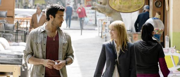 "Jaime Camil as Alejandro and Laura Ramsey as Rachel in ""Pulling Strings."""