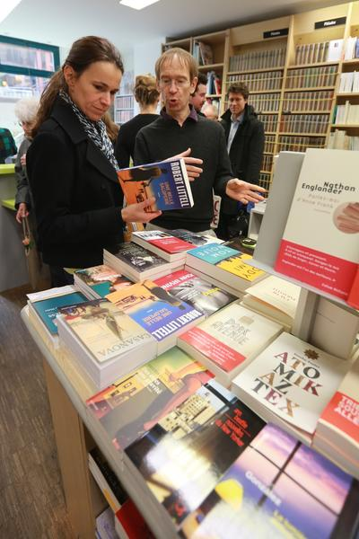 "French Culture Minister Aurelie Fileppetti listens to a seller as she looks for books when participating in a Paris bookshop on April 27, 2013 at the 15th ""Fete de la librairie"" (Bookshops 'festival) dedicated to independemt books sellers."