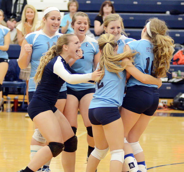 Members of the Petoskey High School varsity volleyball team including (from left) Jayme Larson, Mari Hibbler, Kati Lewis, Tori Visconti, Katie Rash and Trista Boyd celebrate moments following the Northmens five-set 25-17, 15-25, 15-25, 25-20, 15-8 win over Alpena Wednesday at the Petoskey High School gym. The Northmen improved to 9-12-2 overall, 2-4 league with the win.