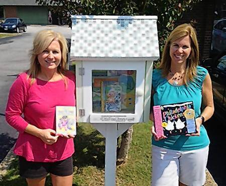Photo courtesy of Ann Adcox Suzanne Hayes, left, and Ann Adcox have opened a Little Free Library at their Pea Soup For Kids children's consignment store in York County.