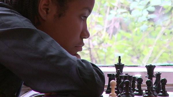 """Middle-school chess star Rochelle Ballantyne contemplates a move in the documentary """"Brooklyn Castle,"""" airing this week on the PBS series """"P.O.V."""""""