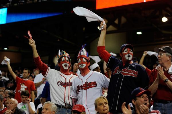 These three Indians fans painted their faces red in support of their team.
