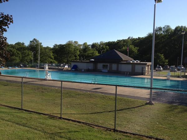 A view of the town pool in Mills Pond Park. Town officials have dropped a proposal to enclose the pool and run it year around.