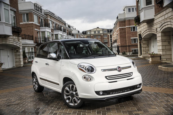 The distinctive European Fiat 500 gets supersized for the American market with the 2014 Fiat 500L, which is longer, taller and bigger than the 500.