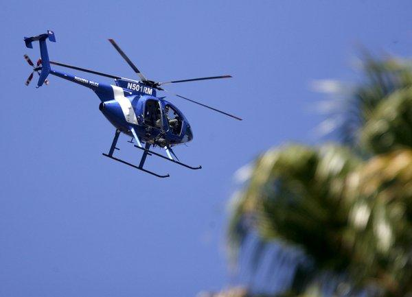 Glendale Police Dept. helicopter officers look for a burglary suspect above and nearby Brand Park in Glendale on Thursday, Sept. 13, 2012.