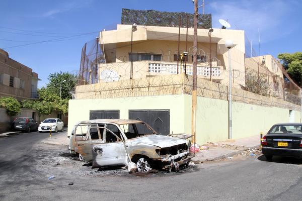 A picture taken Thursday outside the Russian Embassy in Tripoli shows a car destroyed by demonstrators the day before. Dozens of angry protesters tried to storm the embassy after reports that a Russian woman had killed a Libyan army officer, witnesses said.