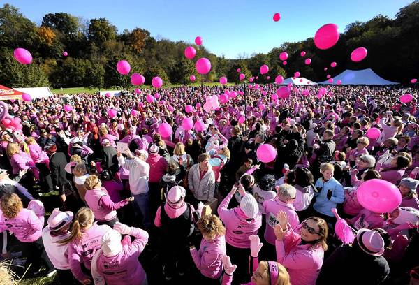 More than 5,000 women and their families gather before the start of the 20th annual Womens 5K classic in the Lehigh Parkway in October 2012.