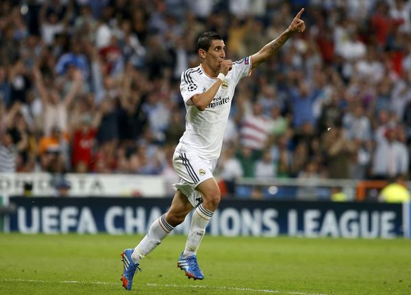 Real Madrid's Angel Di Maria celebrates his goal against FC Copenhagen during their Champions League soccer match at Bernabeu stadium in Madrid October 2, 2013.
