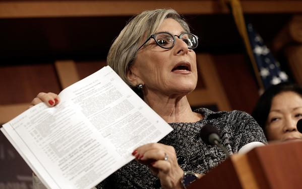 """Democratic Sen. Barbara Boxer, shown at a news conference last month, called Republicans """"sore losers,"""" shutting the government down because of their """"dislike of this president and his signature accomplishment."""""""