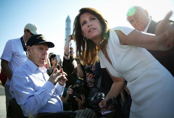 Rep. Michele Bachmann (R-Minn.) comforts a World War II veteran victimized by the government shutdown she supports.