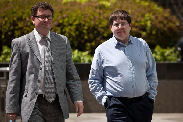Former Reuters social media editor Matthew Keys (R) arrives at the federal courthouse April 23, 2013 in Sacramento, California. Keys was in court to face charges he conspired with the hacking group Anonymous.