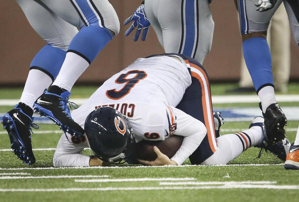 Chicago Bears quarterback Jay Cutler (6) with his head down after being sacked by Detroit Lions middle linebacker Stephen Tulloch (55), during the first half of their game at Ford Field.