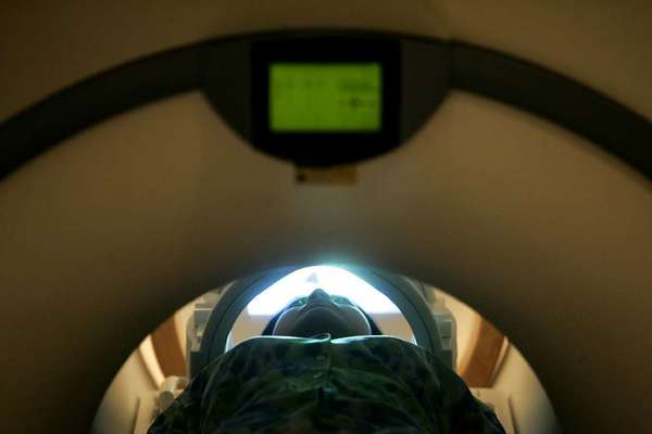 A test subject undergoes an MRI scan. The makers of machines like this want to stick you with their tax bill.