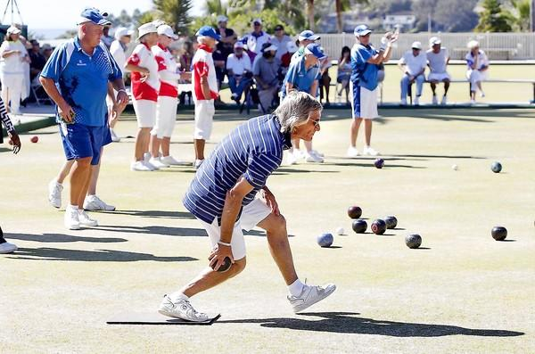 Mert Isaacman steps into a shot as he plays in the Men's Fours in the 2013 U.S. Open of Lawn Bowls Grand Finals at the Laguna Beach Lawn Bowling Club on Saturday.