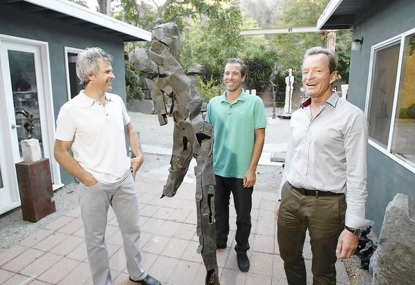 Sculptor Louis Longi, project manager Chris Meddock and architect Horst Noppenberger stand at Longi's studio on Laguna Canyon Road. The group wants to build 30 artist live-work units on an open plot of land in Laguna Canyon.