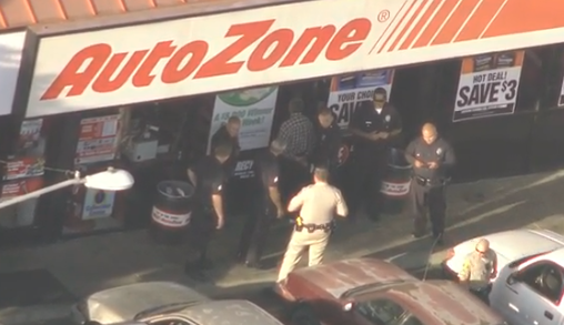 Authorities detain a man after a motorcycle rider led officers on a pursuit across Los Angeles.