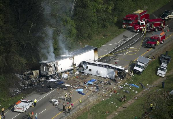In this aerial photo, emergency workers respond to a crash involving a passenger bus, a tractor-trailer and an SUV near Dandridge, Tenn., on Wednesday.