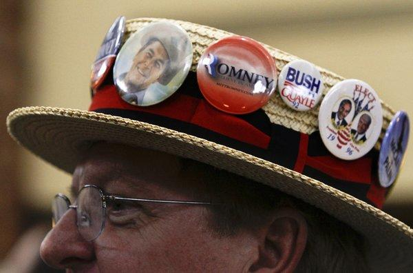 California delegate Gary Felien wears his special straw hat during a breakfast pep rally at last year's Republican National Convention in Tampa, Fla.