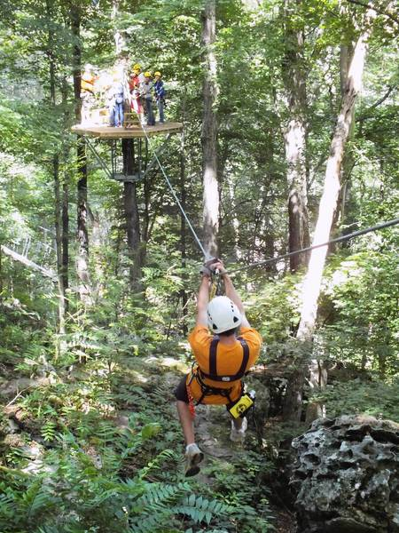 The guests having already crossed to the other side of a ravine, a guide brings up the rear at the Shawnee Bluffs Canopy Tour near Makanda, Ill.