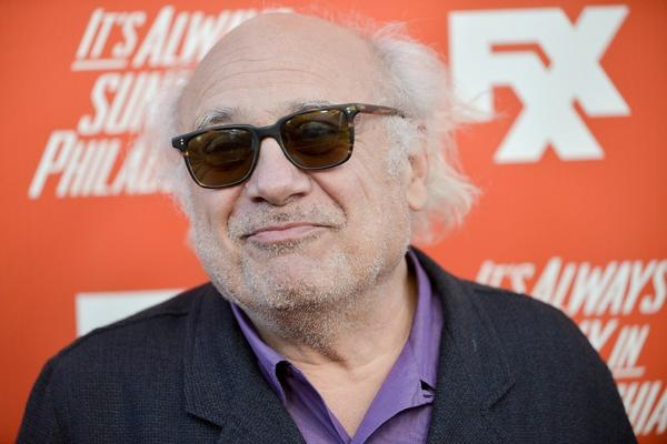 "Danny DeVito costars in FXX's ""It's Always Sunny in Philadelphia."" Exxon has sued over the FXX logo, seen behind DeVito."