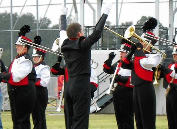 Drum major Cole Bushman, center, directs members of the Leesburg High School marching band during last year's Central Florida Marching Band Festival.