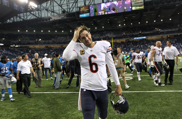 Bears quarterback Jay Cutler walks off the field after losing to the Lions.