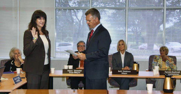 City Manager Michael Cernech swears in Michelle Gomez for District 2.