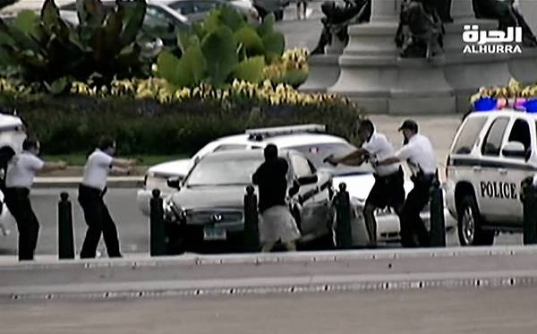 Police surround a car near the U.S. Capitol after a chase down Pennsylvania Avenue. A female driver was fatally shot.