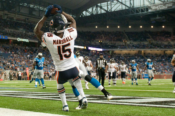 Brandon Marshall completes a two-point conversion during the fourth quarter against the Lions at Ford Field.